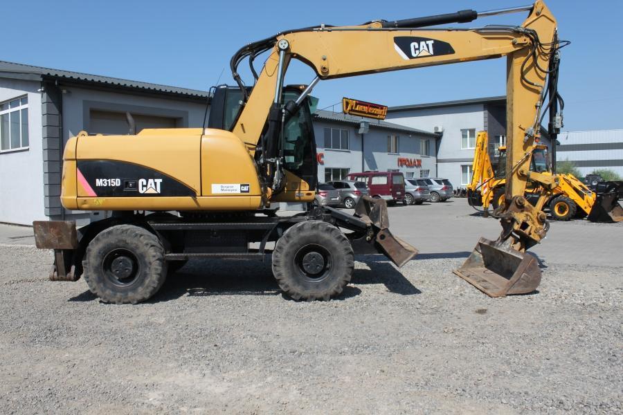Колісний екскаватор Caterpillar (CAT) M315D 2009 р.