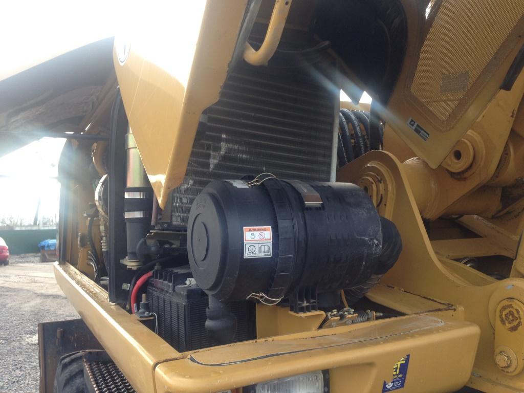 Фото №14 - Колесный экскаватор Caterpillar M316C 2007 г.