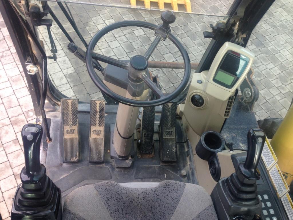 Фото №18 - Колесный экскаватор Caterpillar M316C 2007 г.
