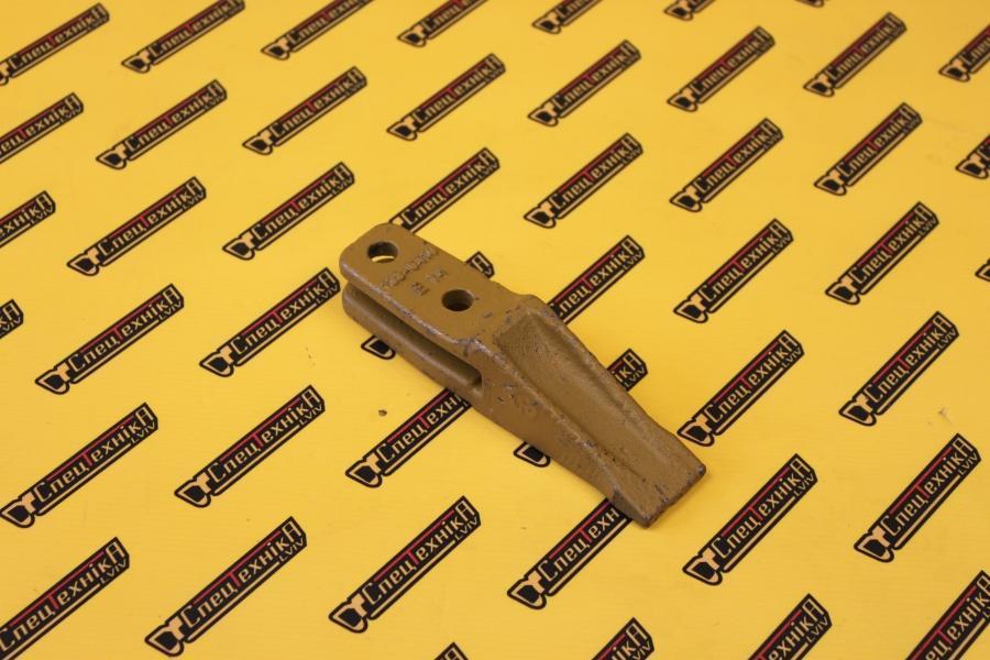 Зуб ковша миниэкскаватора CAT301 1000.14 F (1000.14F)